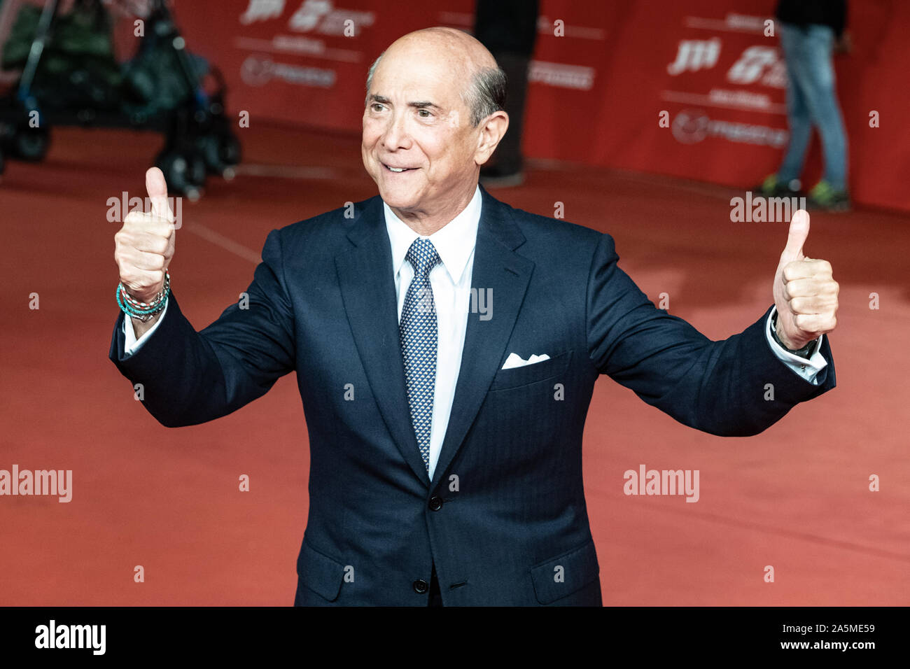 "US ambassador to Italy, Lewis M. Eisenberg gestures as he arrives for the screening of the film ""The Irishman"" during the 14th Rome Film Festival. Stock Photo"
