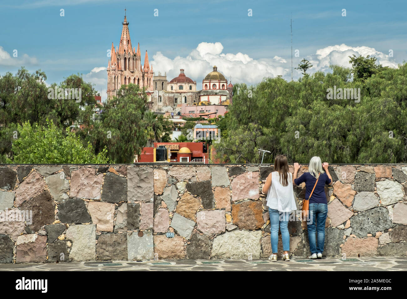 Domes and spires of the Parroquia San Miguel Arcangel church viewed from Instituto Allende in the historic district of San Miguel de Allende, Mexico. Stock Photo