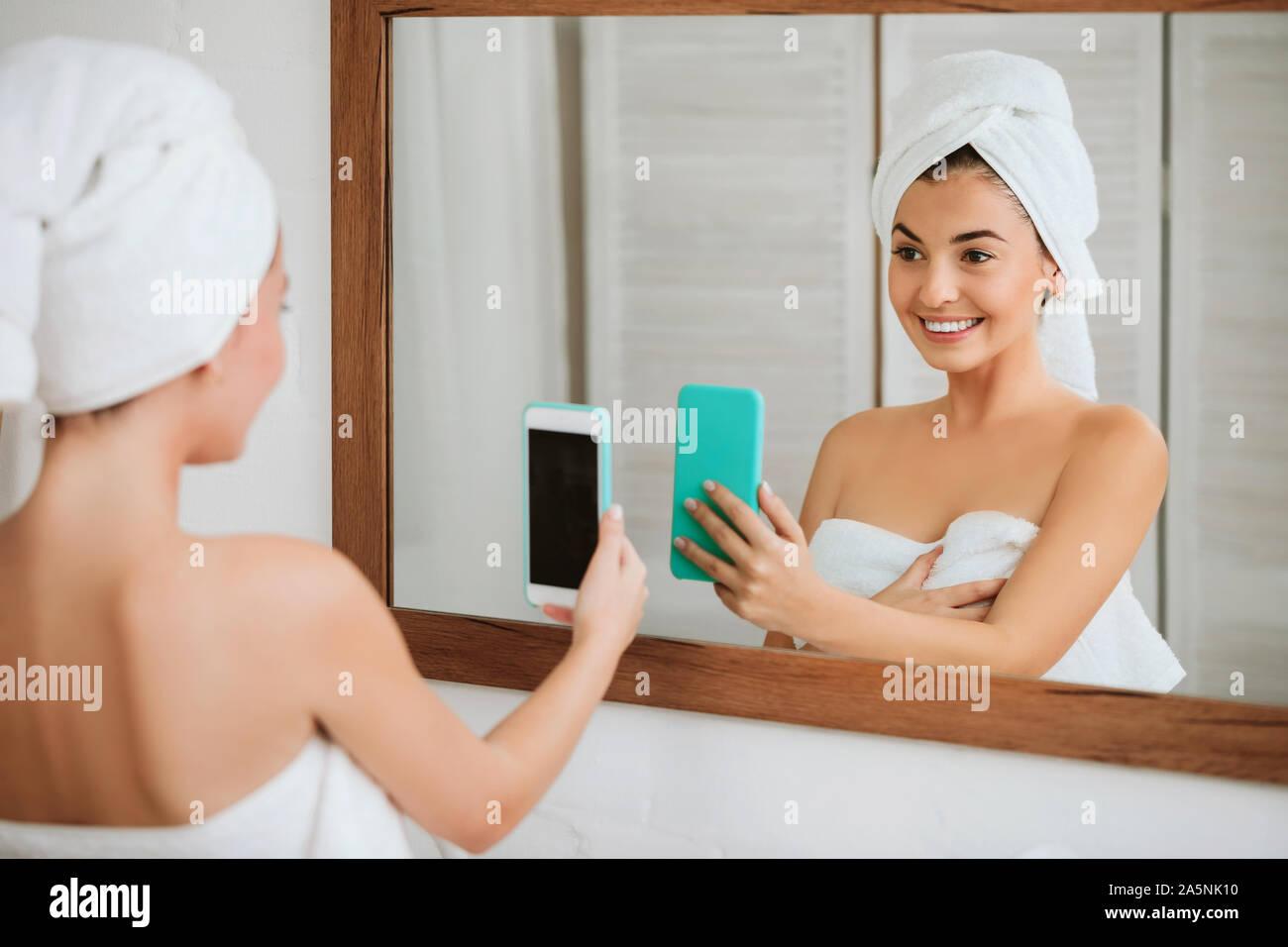 Beautiful Happy Woman In Towel Taking Selfie In Front Of Mirror In The Bathroom Stock Photo Alamy
