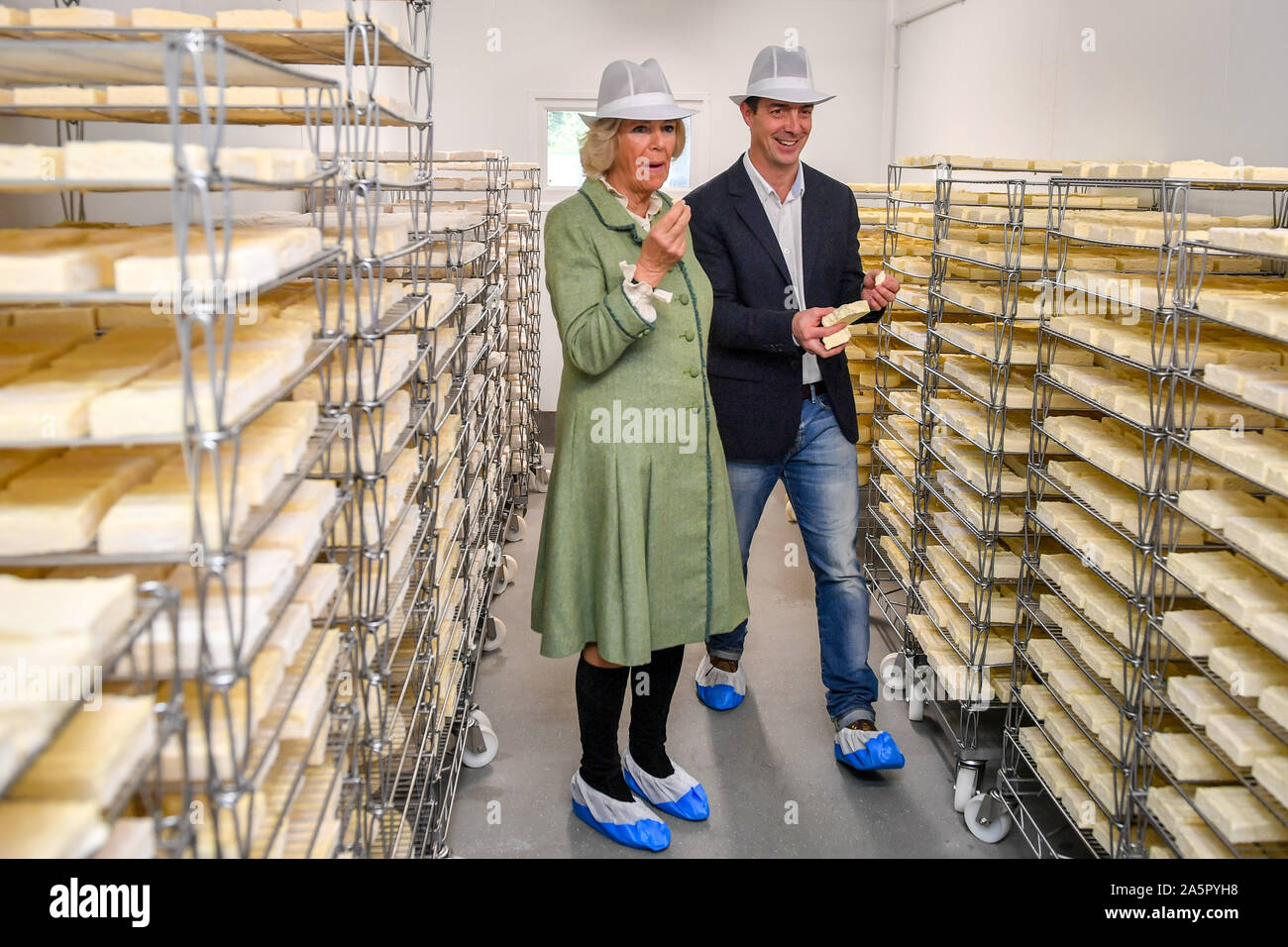 The Duchess Of Cornwall Tastes Ripening Cheeses In A Storage Cold Room Hugh Hadfield During A Visit To The Bath Soft Cheese Company Kelston Bath Stock Photo Alamy