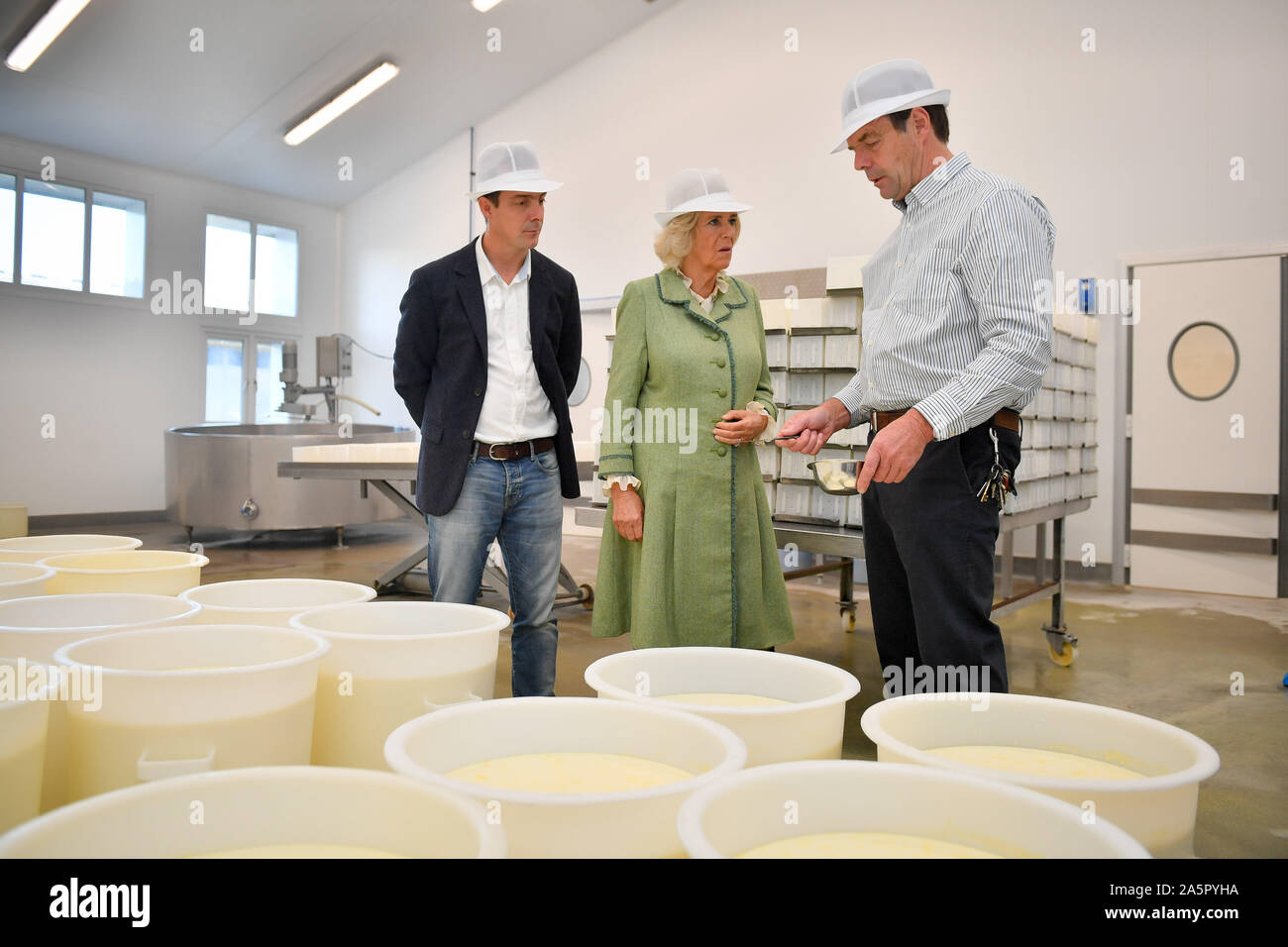 The Duchess Of Cornwall Is Shown Cheese Curds By Father And Son Graham Hadfield Right And