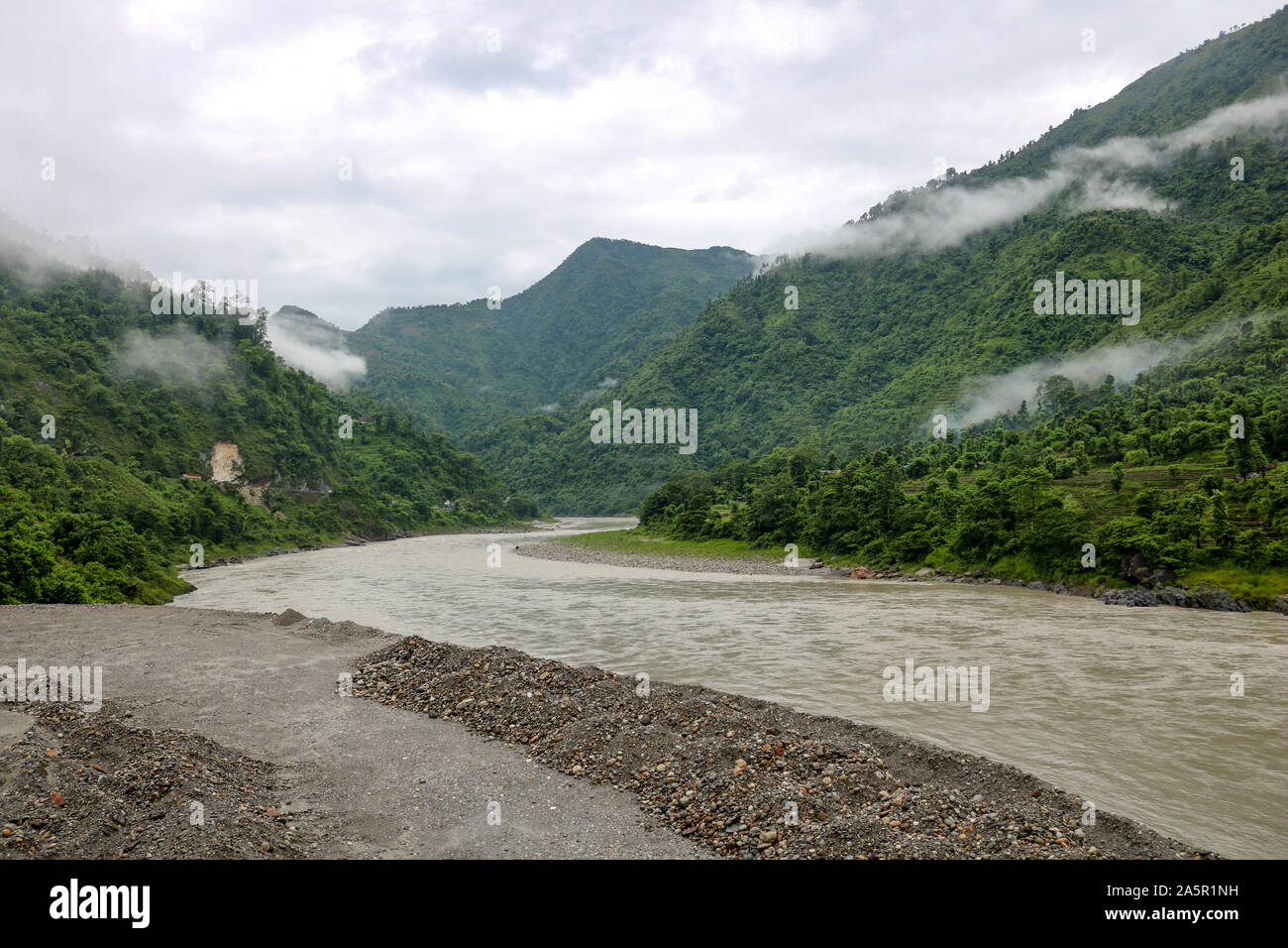 Mountains with forest in the clouds on the banks of the Seti Gandaki river in Nepal Stock Photo