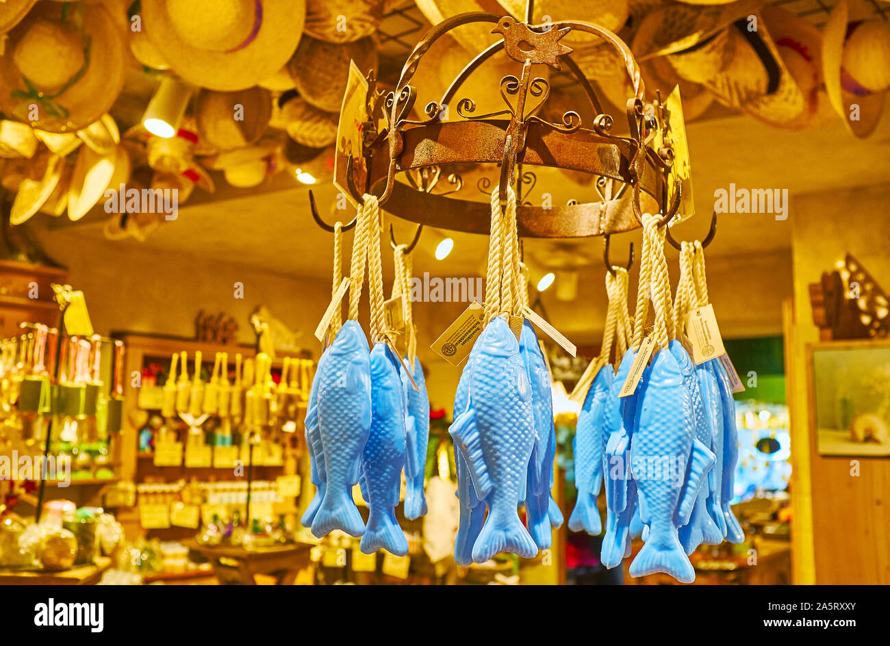 HALLSTATT, AUSTRIA - FEBRUARY 25, 2019: The blue fish shaped soap is hanging on the vintage round rack in old Salzkontor store, famous for high qualit Stock Photo