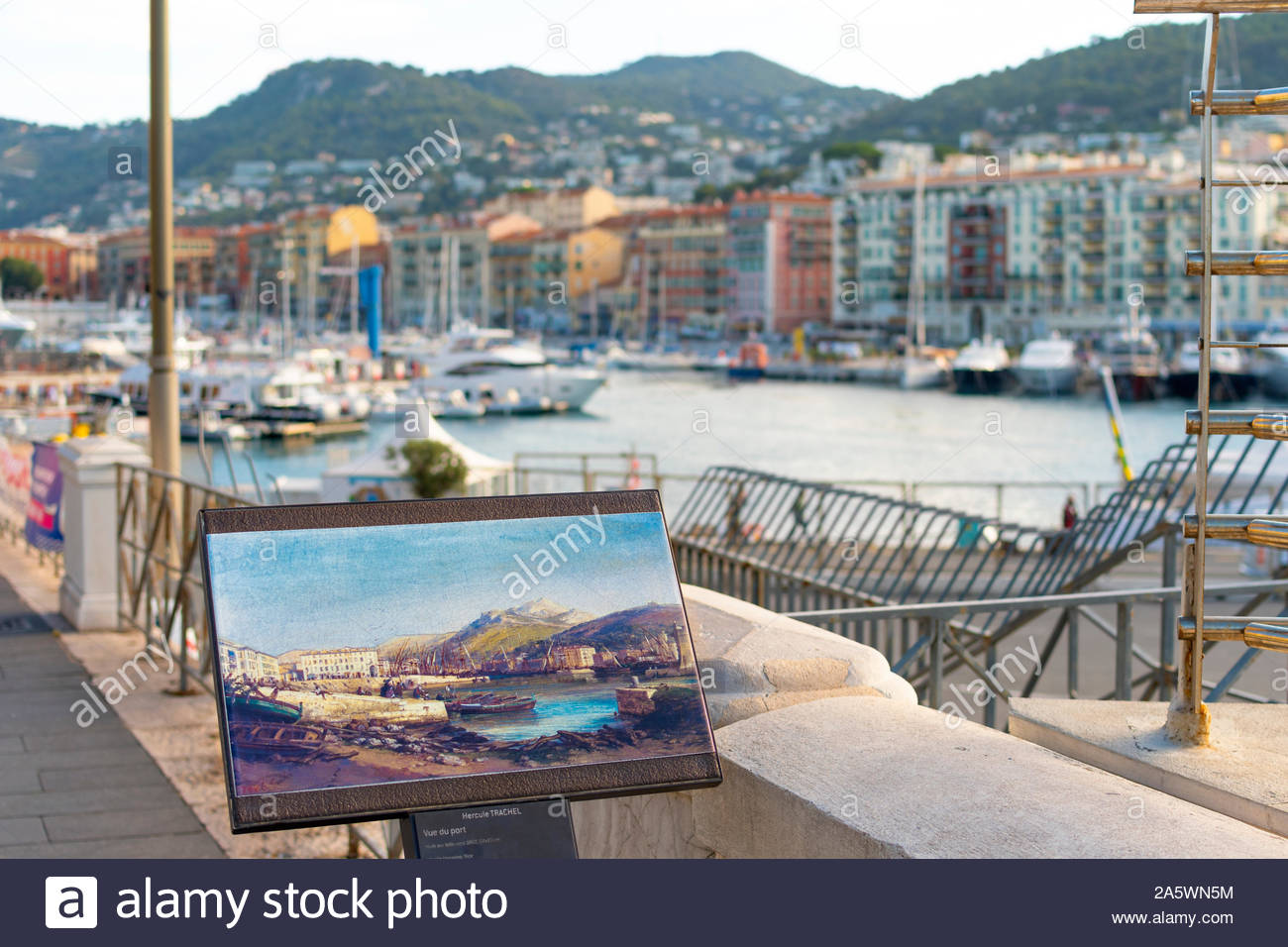 A painting on the docks and shoreline depecting historic port at the harbor of Nice, France, on the Mediterranean Sea. Stock Photo