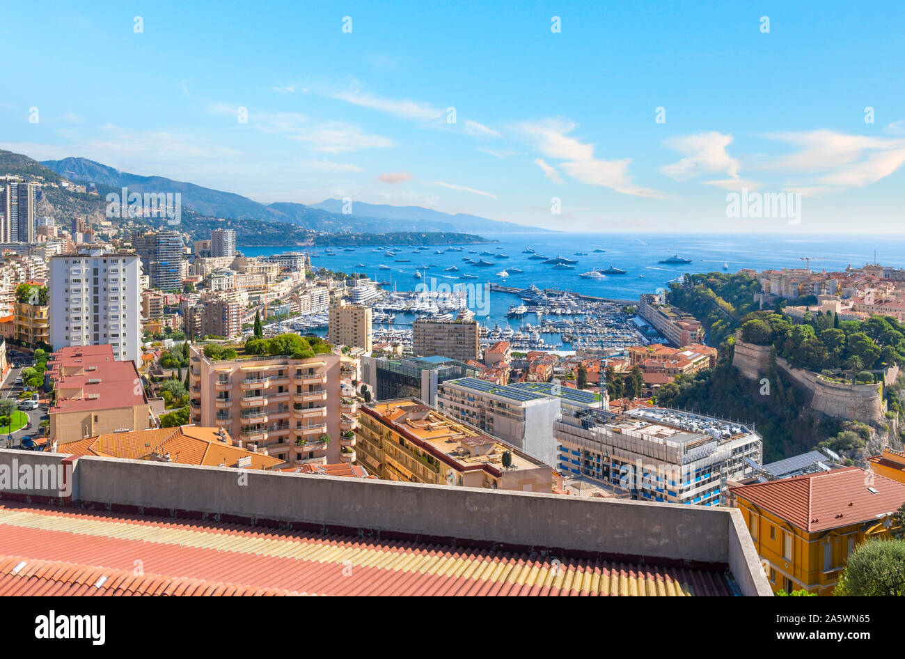 View of the Mediterranean Sea, and the marina, port, city and rock of Monte Carlo, Monaco from a terrace high on a hill Stock Photo