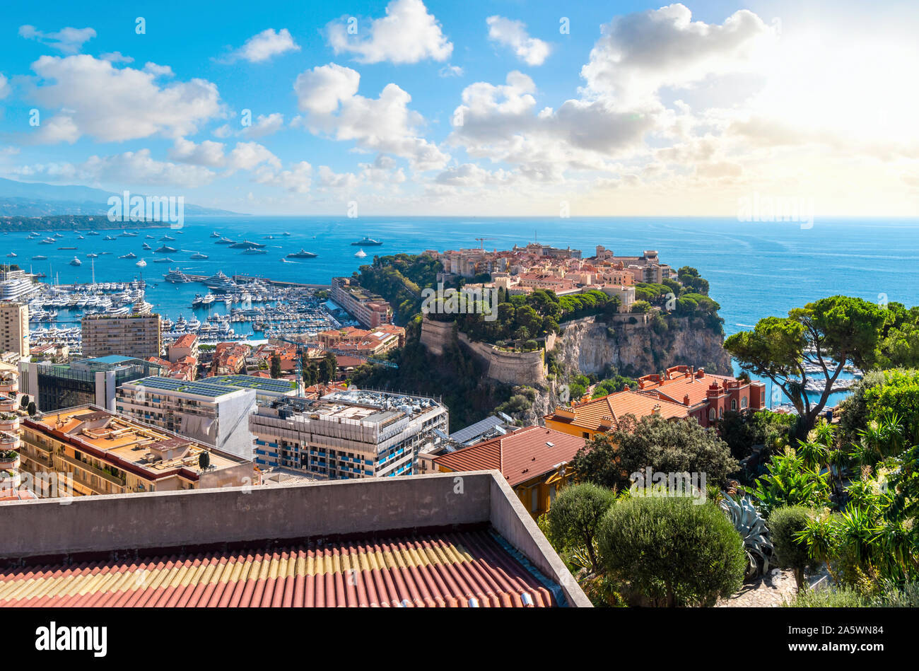 View of the Mediterranean Sea, and the marina, port, city and rock of Monte Carlo, Monaco, as the sun begins to set. Stock Photo