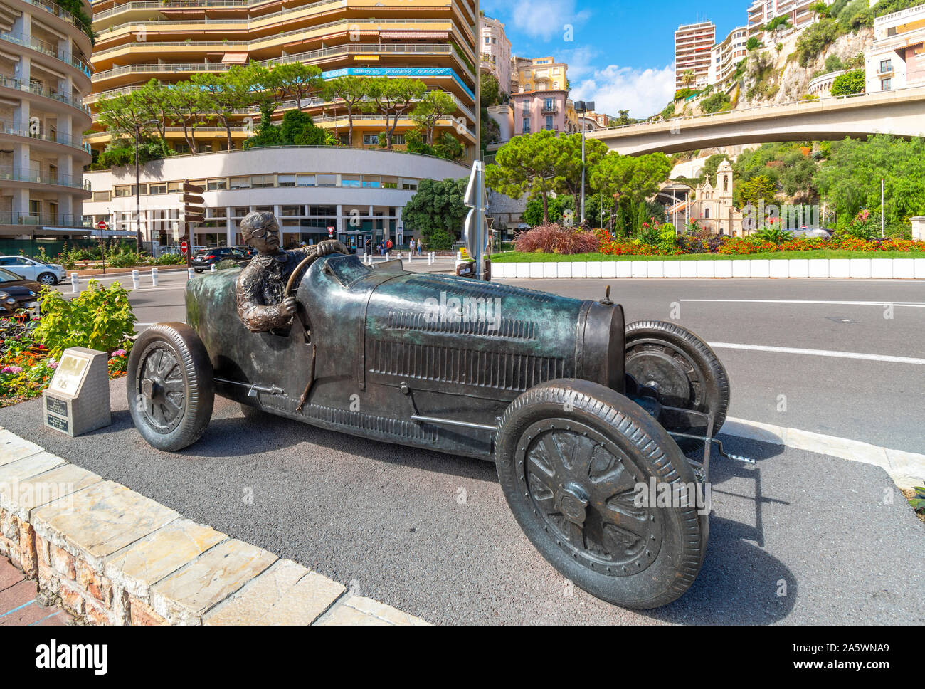 The statue of William Grover in his 1929 Bugatti, the first winner of the Monaco Formula 1 Grand Prix on the street circuit in front of Sainte-Dévote. Stock Photo