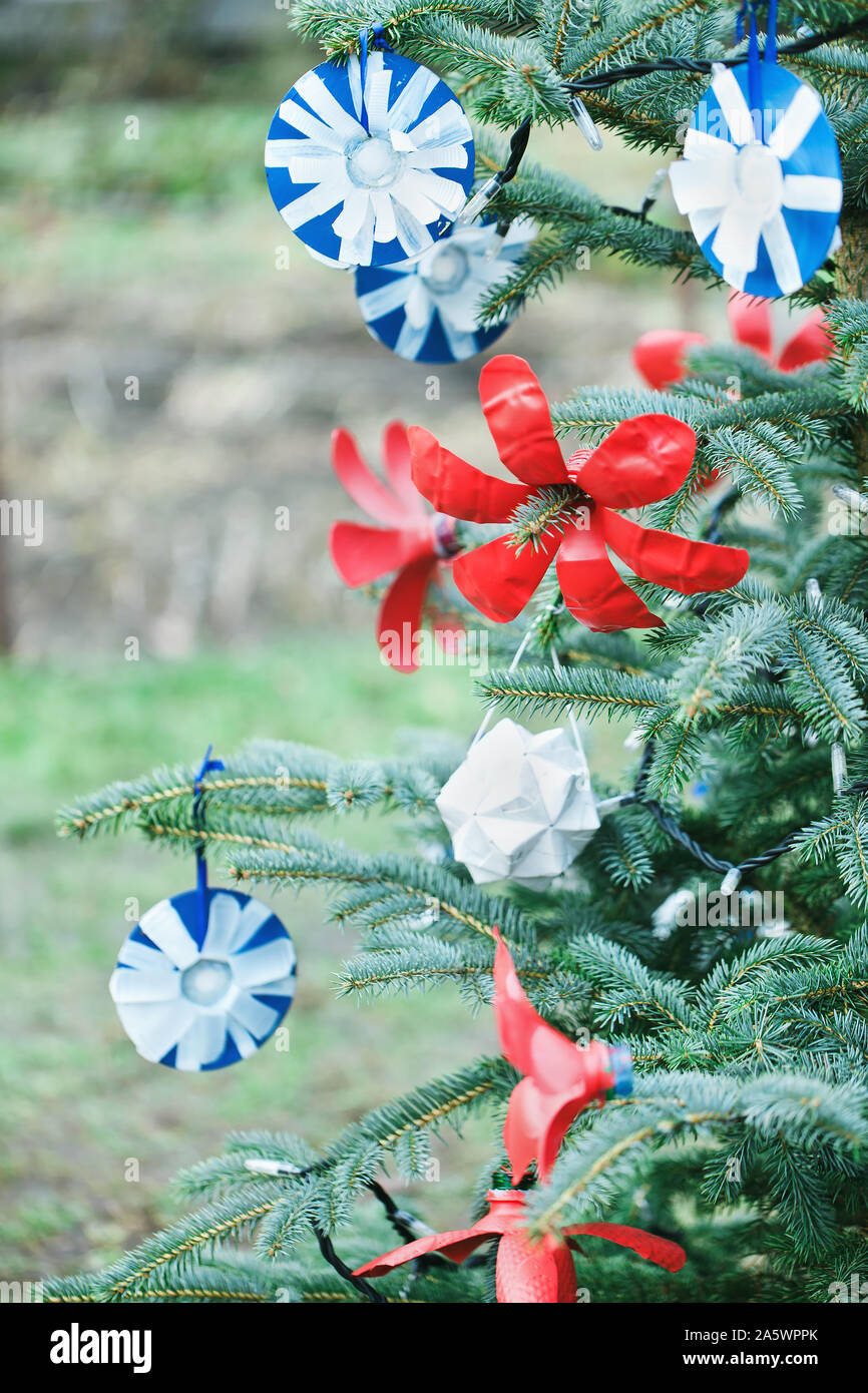 Handmade Decoration Made Of Paper And Plastic Bottle On A Christmas Tree Outdoor Diy Creative Ideas For Children Environment Recycle And Zero Waste Stock Photo Alamy