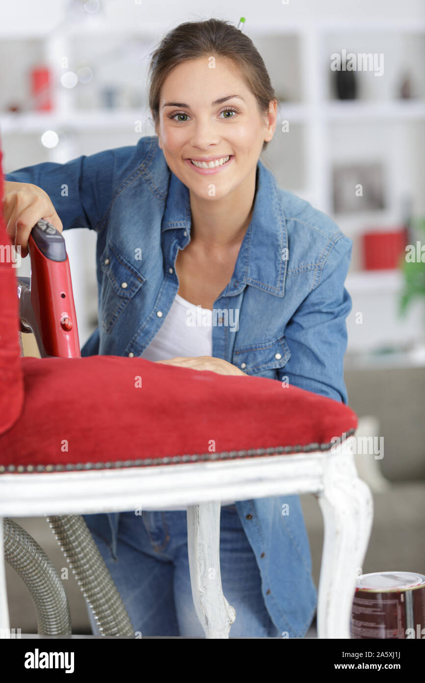 woman fixing a chair with staple Stock Photo