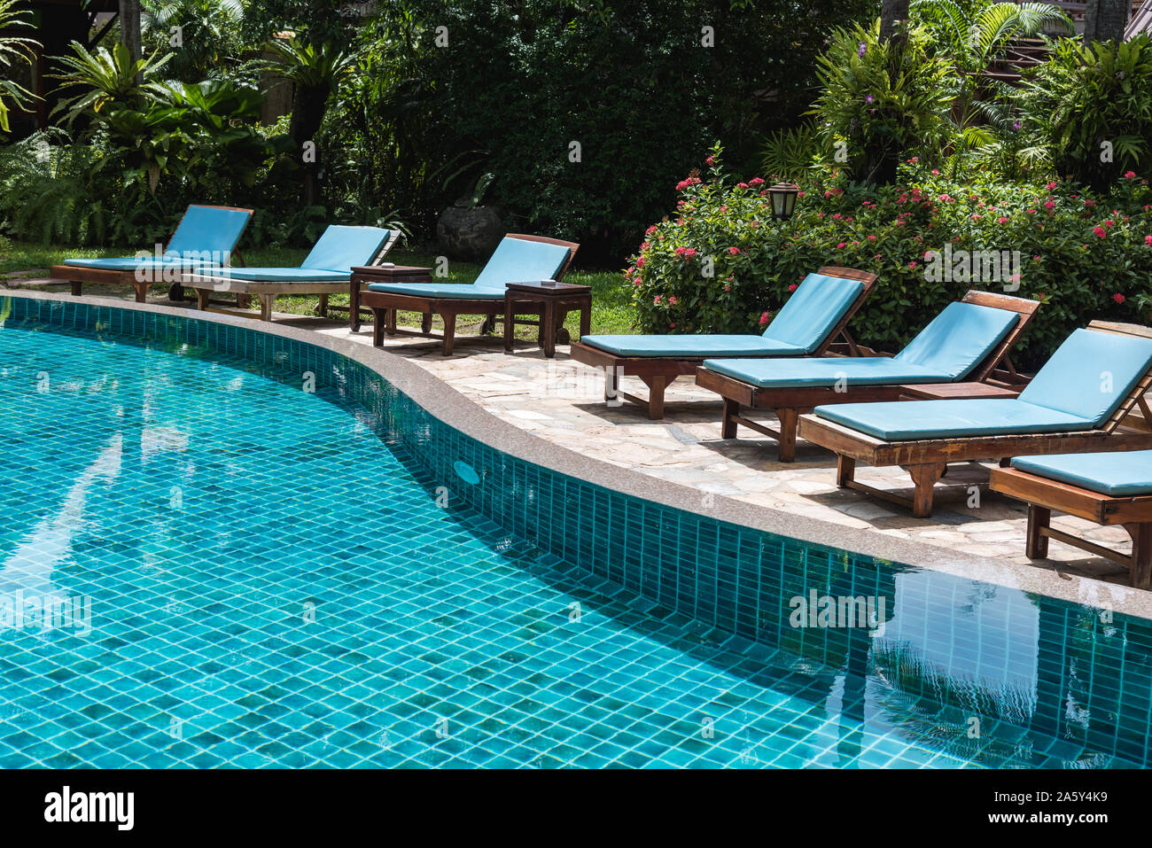 Outdoor Natural Gas Fire Pit Table, Nobody Lounge Chairs Near Swimming Pool In Hotel Resort Stock Photo Alamy