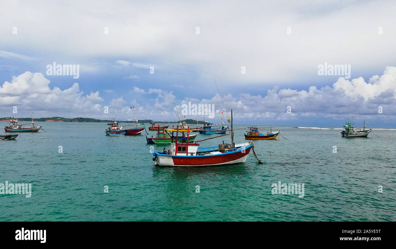 Sri Lankan traditional fishing catamarans, Colorful fishing boats docked docked in the port of Beruwala, Sri Lanka.Srilankan traditional fishing indus Stock Photo