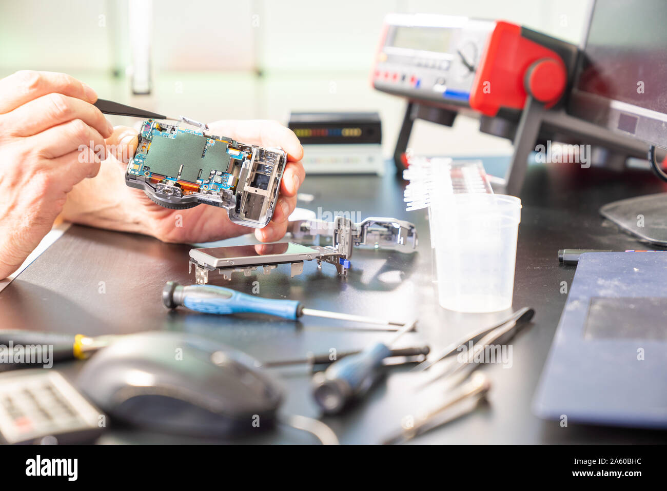 repair of photo camera in services support Stock Photo