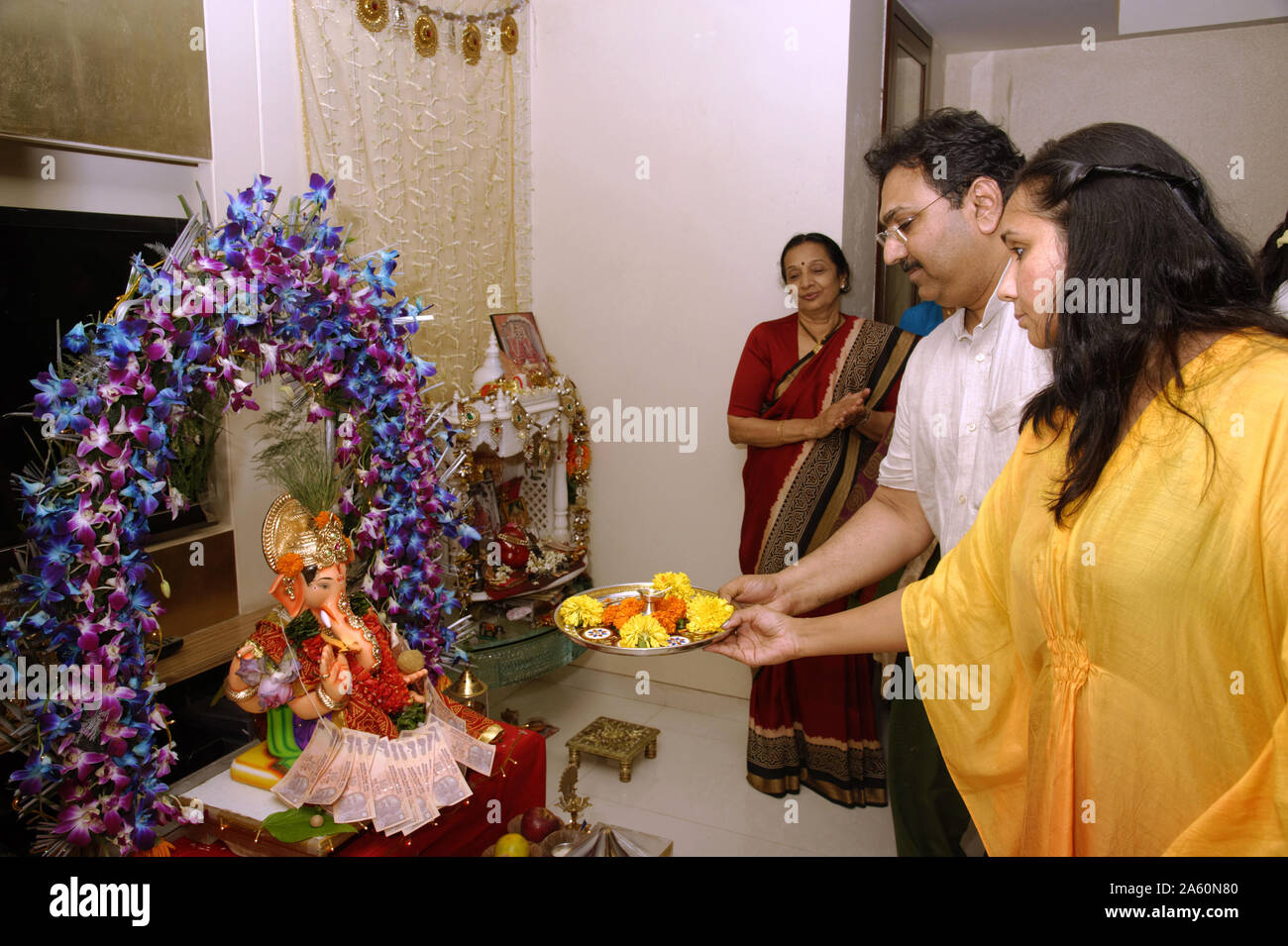 Mumbai, Maharashtra, India, Southeast Asia : Ganpati festival; Idol of Lord Ganesh Pooja (Puja) Performing by Devotees; family before immersion. Stock Photo