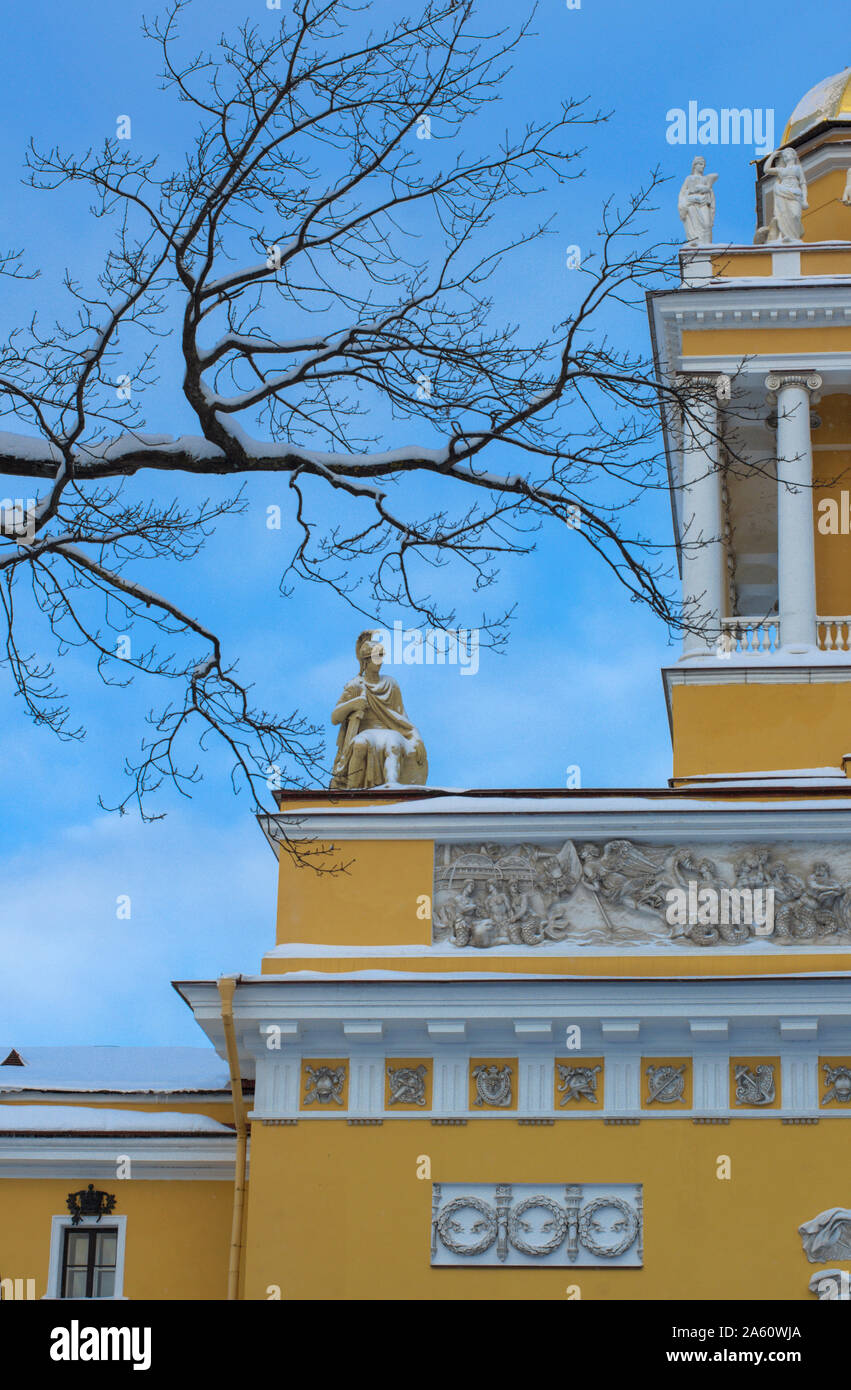 Ancient statue of a warrior-hero covered with snow framed by branches on the Admiralty building (St. Petersburg) vertical orientation Stock Photo