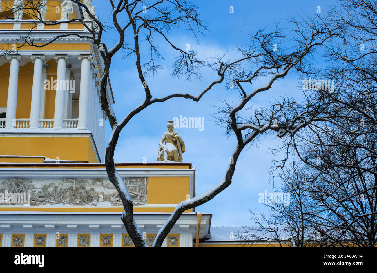 Ancient statue of a warrior covered with snow framed by arched branches on the Admiralty building (St. Petersburg) Stock Photo