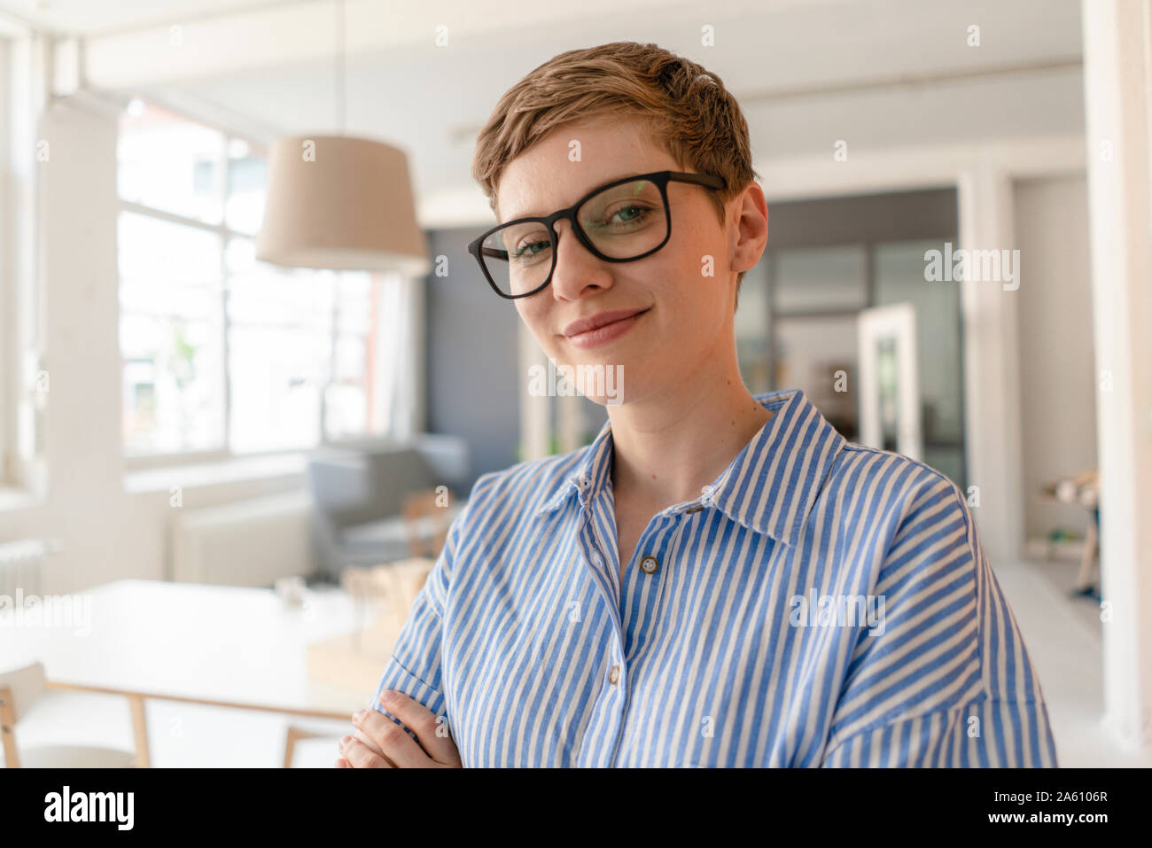 Portrait of smiling businesswoman in office Stock Photo