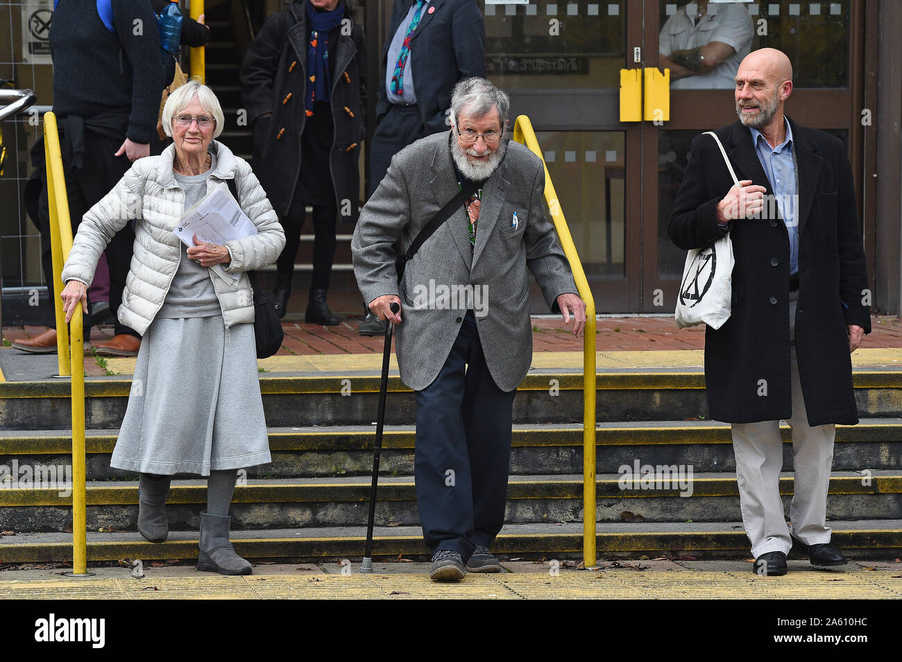 """(left to right) Extinction Rebellion activists Ursula Pethick, 83, John Lynes, 91, and John Halladay, 61, leaving Folkestone Magistrates' Court where they appeared for their part in the """"blockade"""" of the Port of Dover in September. Stock Photo"""