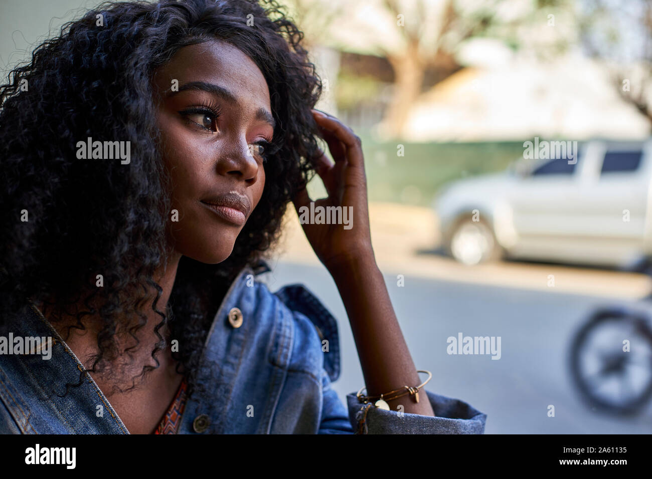 Portrait of young African woman in a cafe, looking out of window Stock Photo