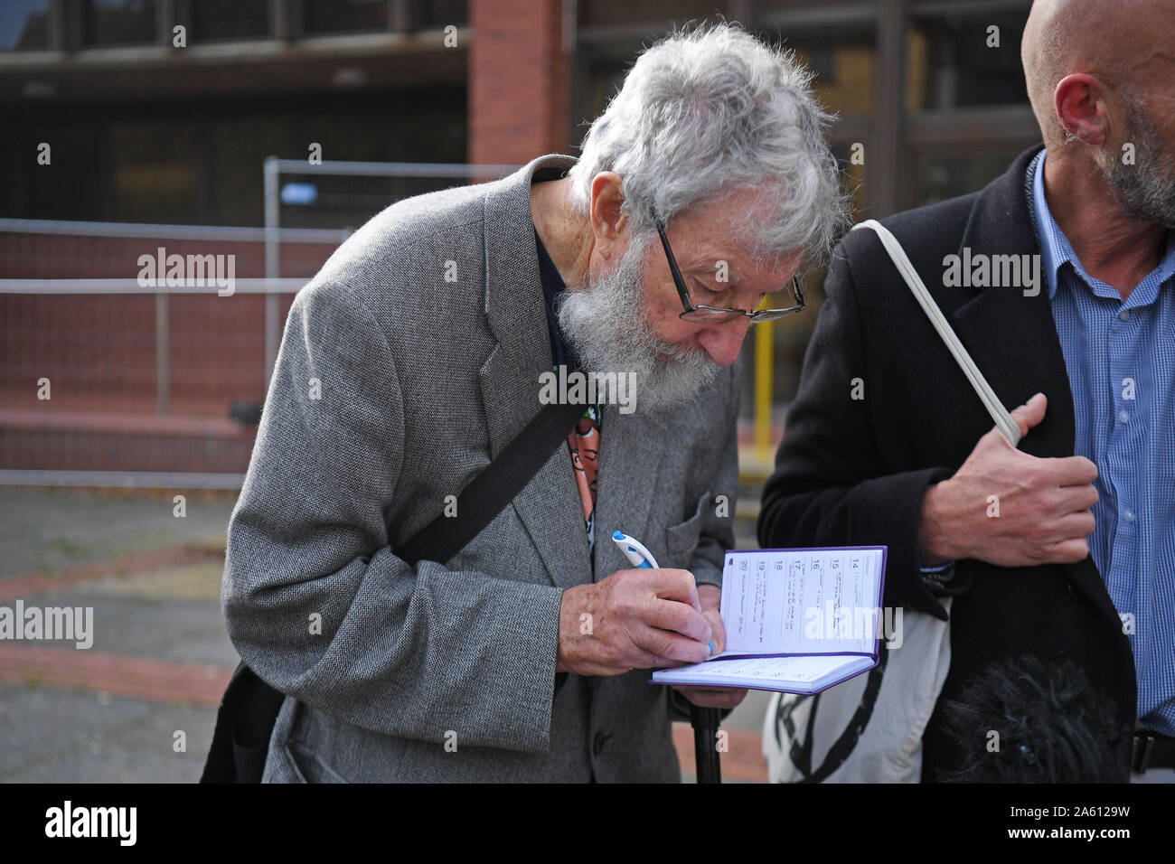 """Extinction Rebellion activist John Lynes, 91, leaving Folkestone Magistrates' Court where he and others appeared for their part in the """"blockade"""" of the Port of Dover in September. PA Photo. Picture date: Wednesday October 23, 2019. During the demonstration protesters occupied one side of a dual carriageway at the busy Kent trade hub amid a heavy police presence. See PA story COURTS Protests. Photo credit should read: Kirsty O'Connor/PA Wire Stock Photo"""