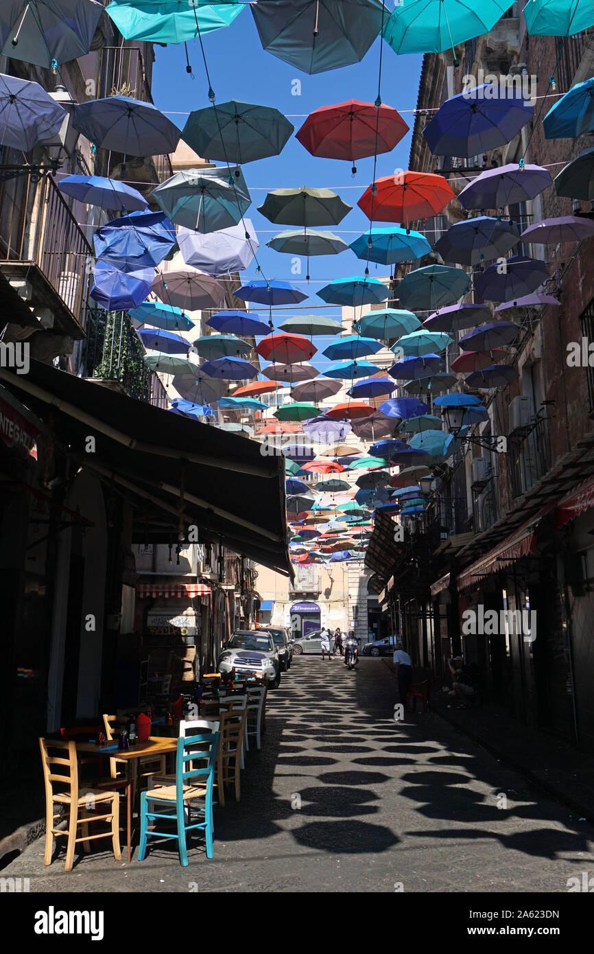 The colorful umbrellas of the Umbrella Sky Project in Via Gisira and Via Pardo, Catania, Sicly, Italy, Stock Photo