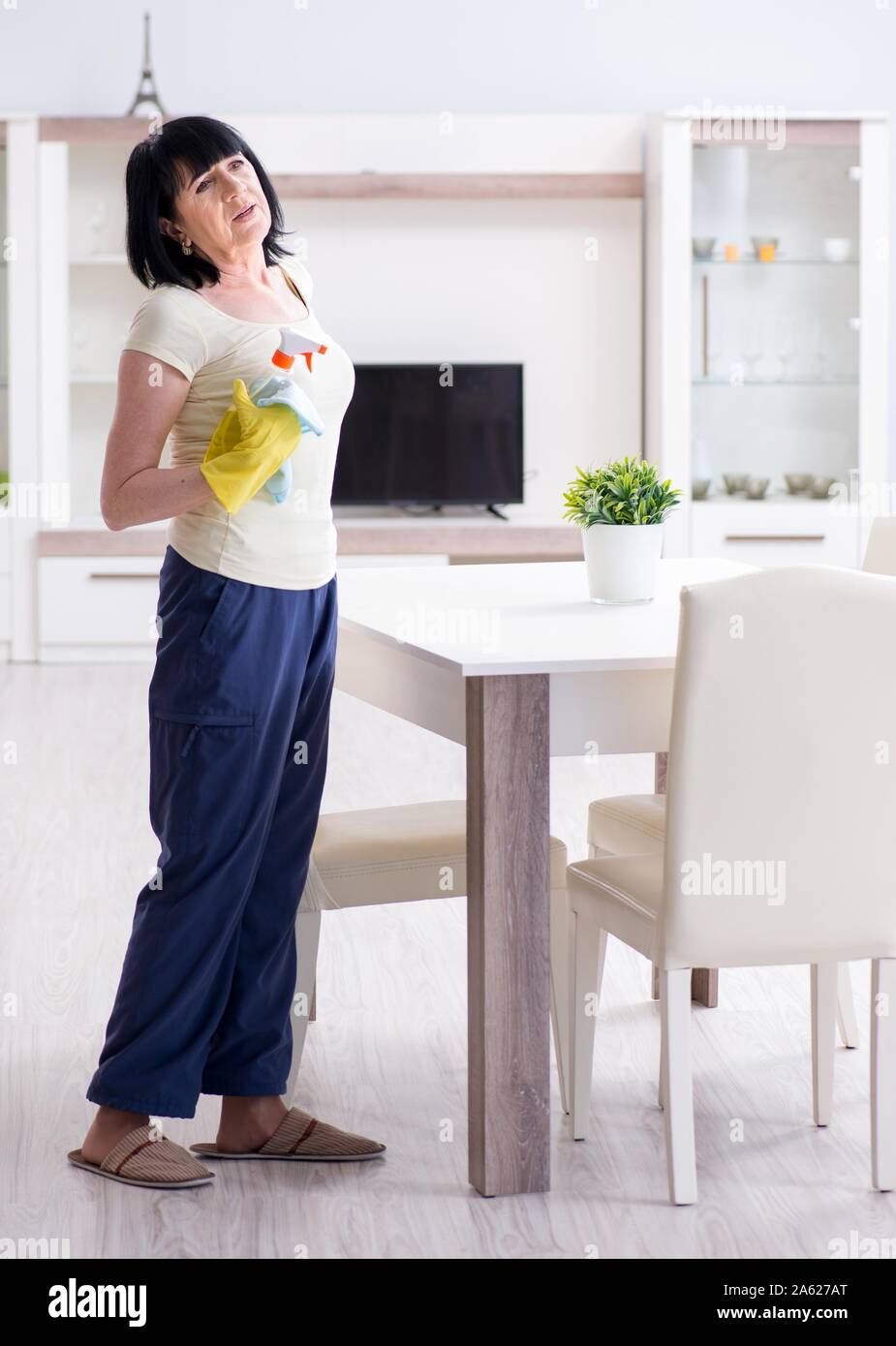 The Old Mature Woman Tired After House Chores Stock Photo