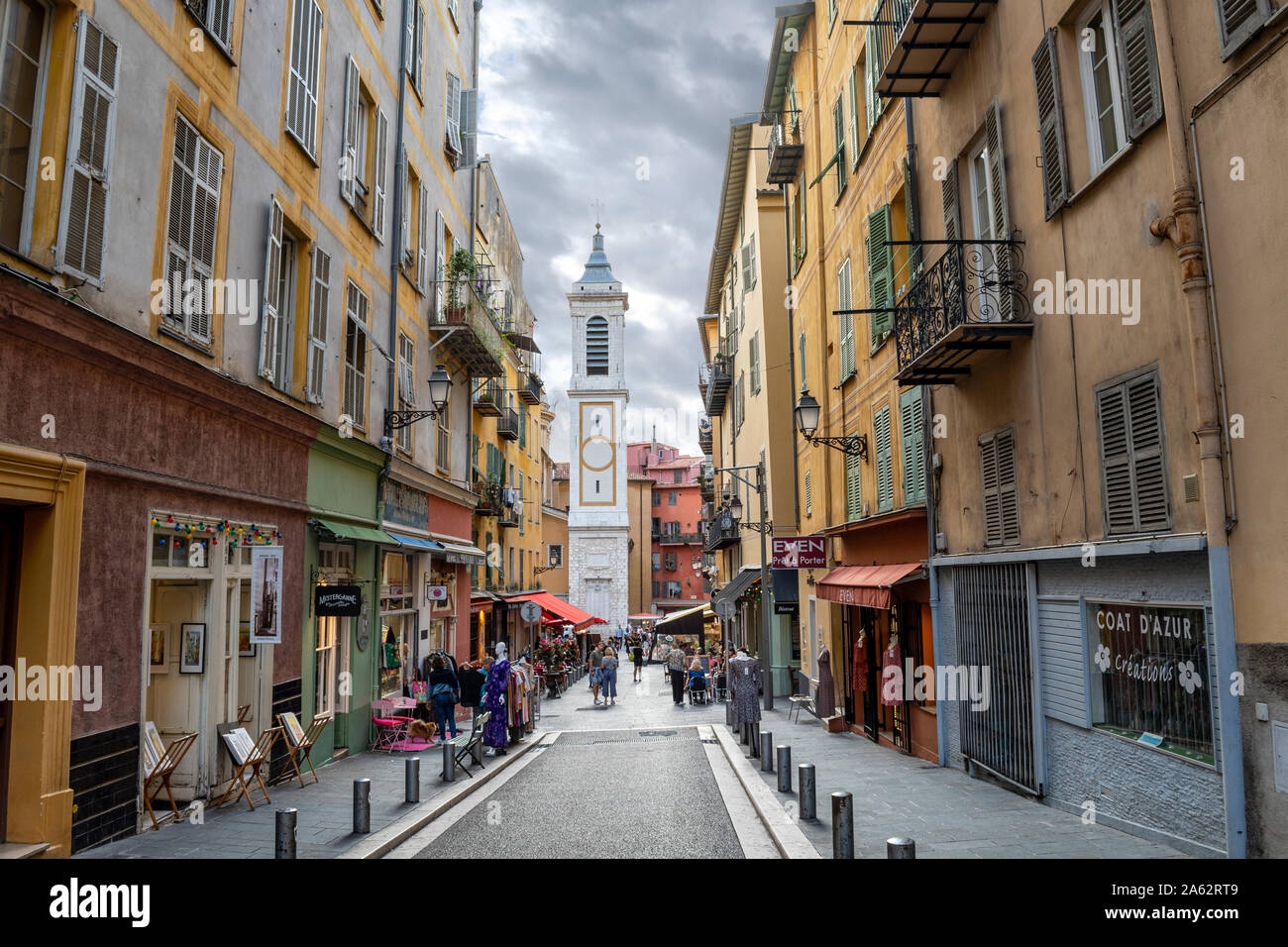 View of the campanile bell tower of the Nice Cathedral at Place Rossetti as tourists enjoy the late afternoon in Nice, France. Stock Photo