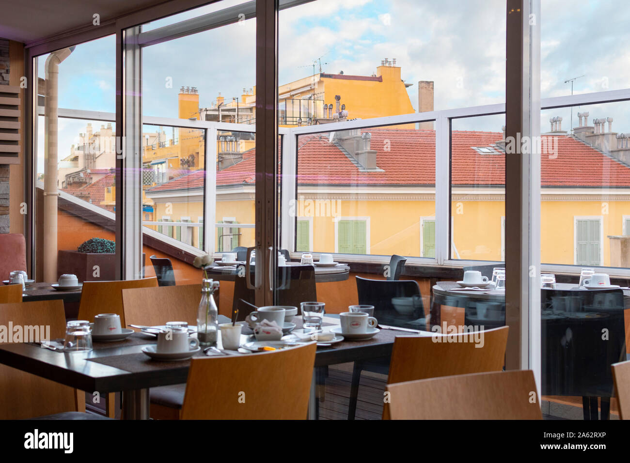 An empty table yet to be cleaned at a rooftop cafe in the Mediterranean city of Nice France. Stock Photo