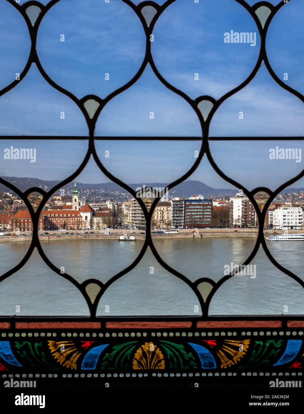 A view over Danube river and houses from Hungarian Parliament Building's window. Stock Photo