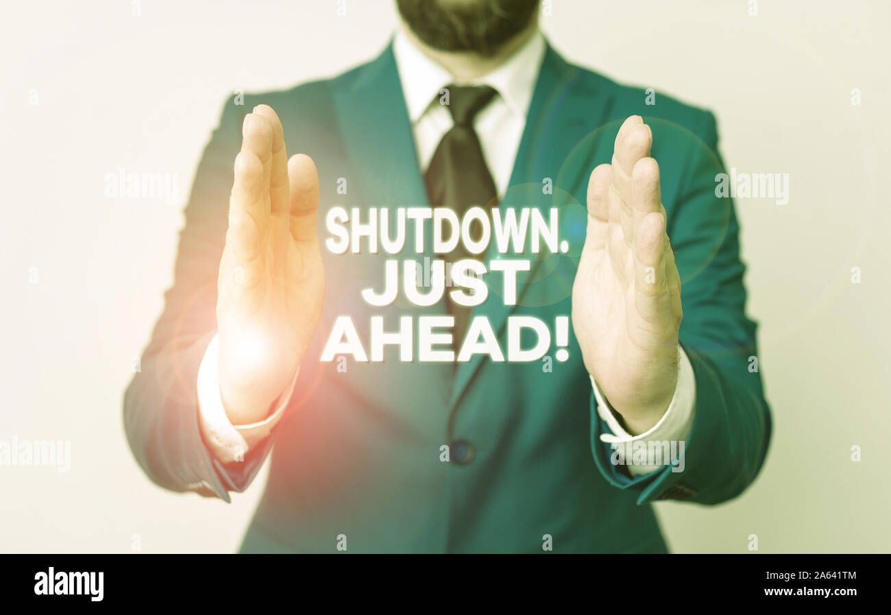 Word writing text Shutdown Just Ahead. Business photo showcasing closing factory business either short time or forever Man with opened hands in fron o Stock Photo