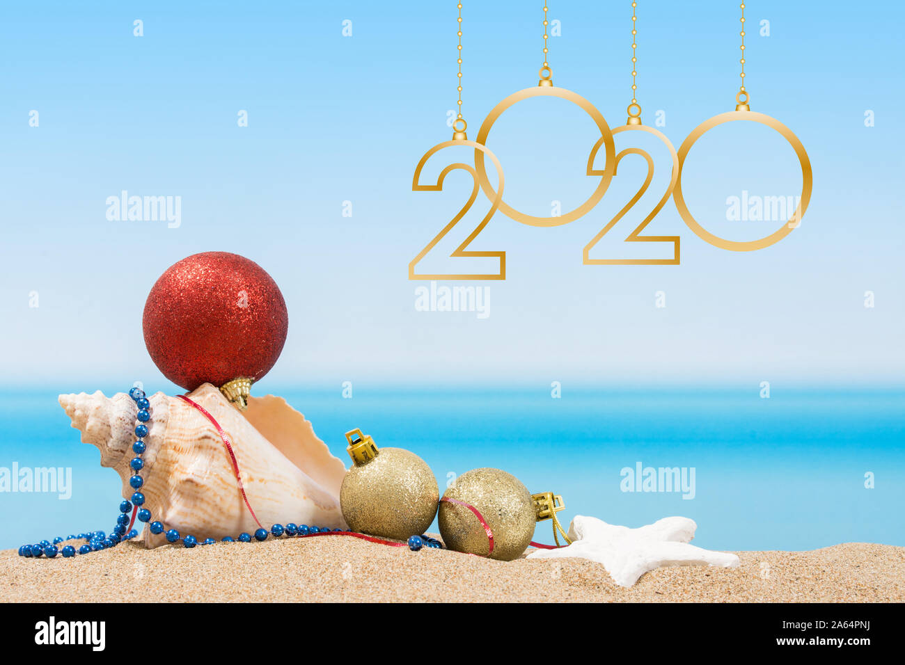 Beach Vacation Christmas 2020 new year 2020. Christmas tree decorations on the beach in tropical