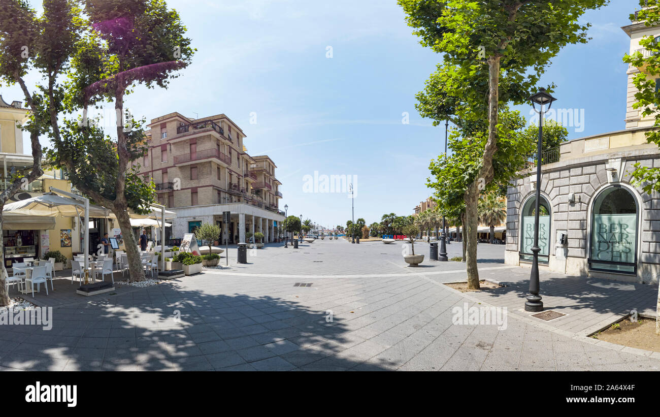 Ostia Lido Rome, Italy - July 19, 2019: Immersive panoramic street view of Anco Marzio square from Stazione Vecchia street ,with palaces facades  and Stock Photo