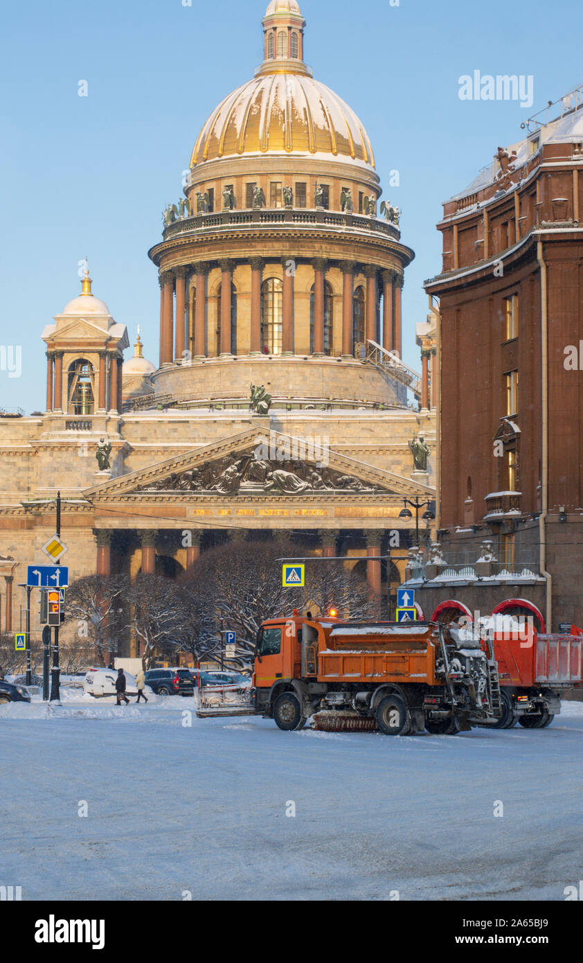 Winter morning near St. Isaac's Cathedral snow removal equipment clears the city of the fallen snow (St. Petersburg, Russia) Stock Photo