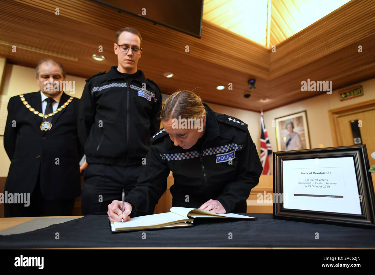 (left to right) Mayor of Thurrock Terry Piccolo, Superintendent Craig Saunders and Chief Inspector Claire Talbot (both of Essex Police) sign the Book of Condolence in the Council Chamber of Thurrock Council in Grays, Essex, after 39 bodies were found inside a lorry at Waterglade Industrial Park in Grays, Essex, on Wednesday. Stock Photo