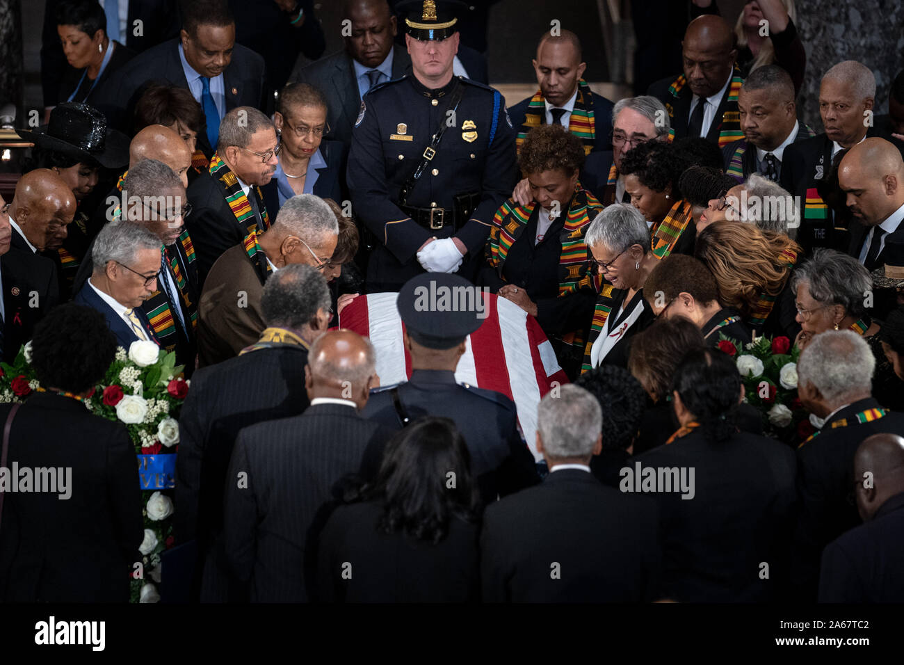 Washington, United States. 24th Oct, 2019. Members of the Congressional Black Caucus gather around the casket at a memorial service for late Maryland Representative Elijah Cummings in National Statuary Hall at the U.S. Capitol in Washington, DC on Thursday, October 24, 2019. Cummings died at the age of 68 on October 17 due to complications concerning long-standing health challenges. Pool Photo by Erin Schaff/UPI Credit: UPI/Alamy Live News Stock Photo