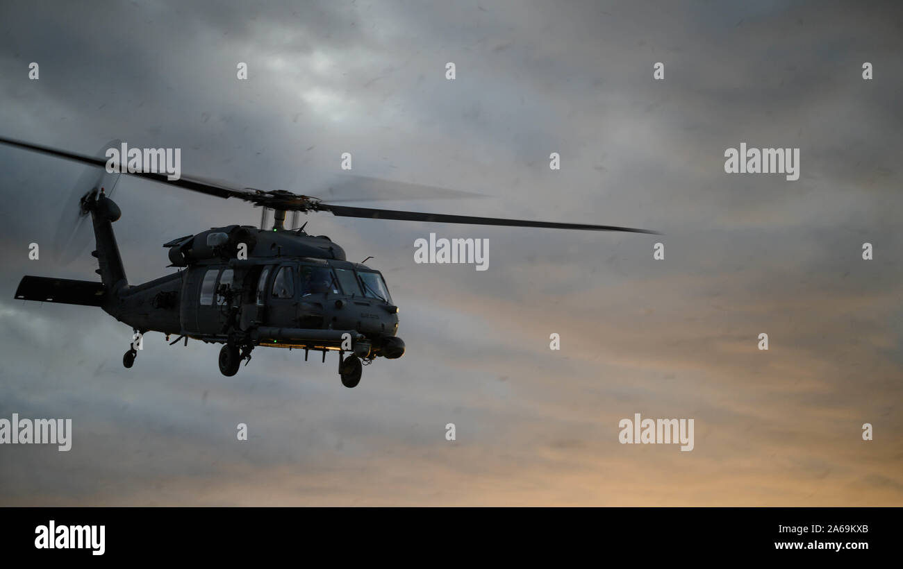 A U.S. Air Force HH-60 Pave Hawk with 31st and 33rd Rescue Squadron, lands on the airfield during exercise Beverly High 20-1 at Ie Shima airfield, Japan on Oct. 21, 2019. The exercise was an integration of Marines and Airmen designed to rehearse combat employment of rescue forces to an austere location and establish communications in any environment. (U.S. Marine Corps photo by Cpl. Kallahan Morris) Stock Photo