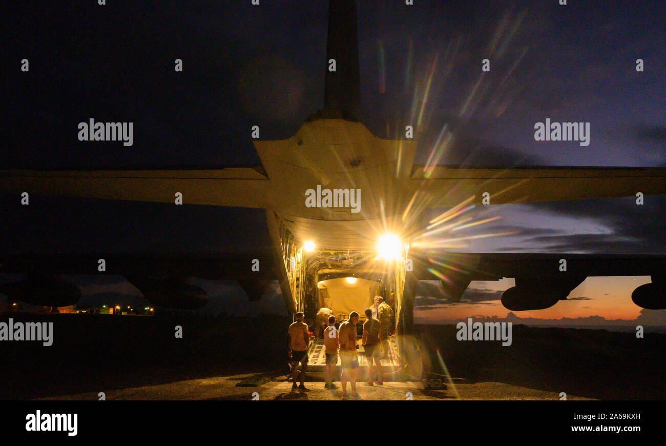 U.S. Airmen with 31st and 33rd Rescue Squadron, off-load equipment from a C-130J Super Hercules during exercise Beverly High 20-1 at Ie Shima airfield, Japan on Oct. 21, 2019. The exercise was an integration of Marines and Airmen designed to rehearse combat employment of rescue forces to an austere location and establish communications in any environment. (U.S. Marine Corps photo by Cpl. Kallahan Morris) Stock Photo