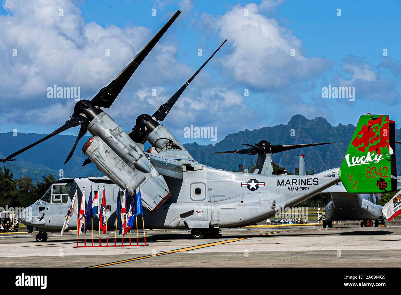 A MV-22B Osprey with the Marine Medium Tiltrotor Squadron 363 is staged for a change of command ceremony on Marine Corps Air Station, Kaneohe Bay Hawaii, October 24, 2019. Lt. Col. Brian N. Clifton, outgoing commanding officer, relinquished command to Lt. Col. Eric A. Sandberg. (U.S. Marine Corps photo by Lance Cpl. Jacob Wilson) Stock Photo