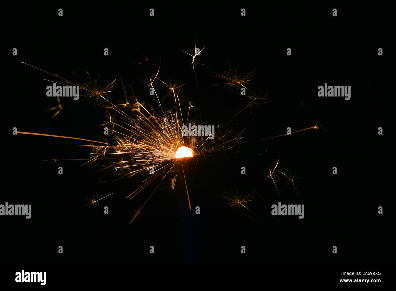 sparkler alight in the dark to celebrate November 5th or Bonfire Night or Guy Fawkes also used to celebrate 4th July and other holidays and festivals Stock Photo
