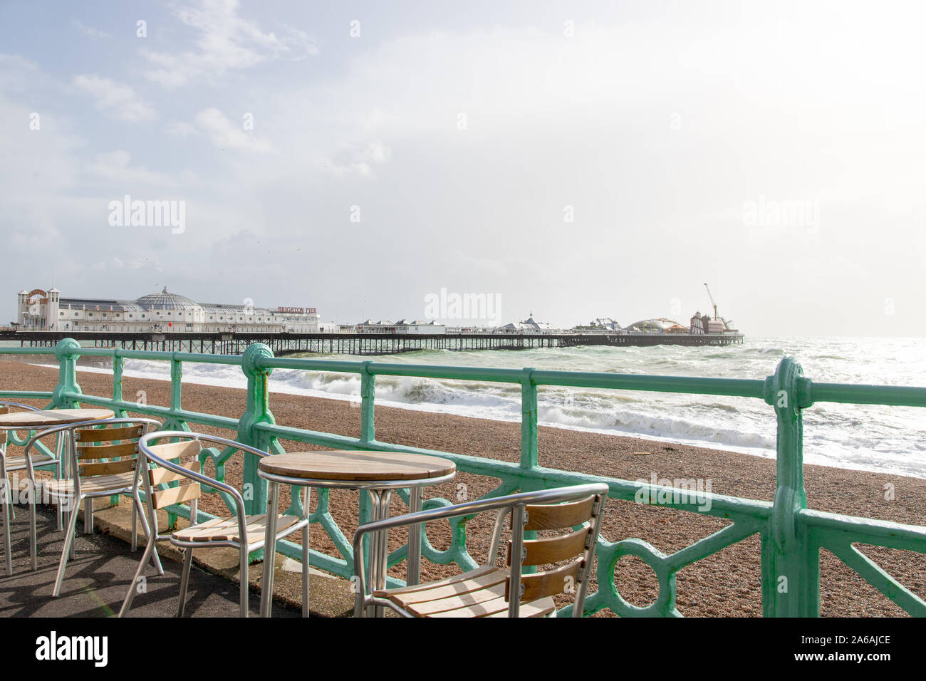 View of the Brighton palace  pier from a coffee shop terrace with chairs and tables Stock Photo