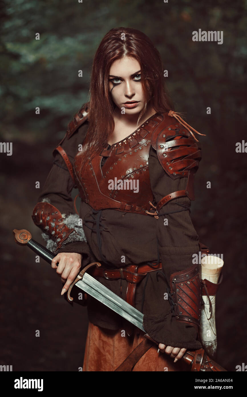 Beautiful female warrior with leather armor Stock Photo