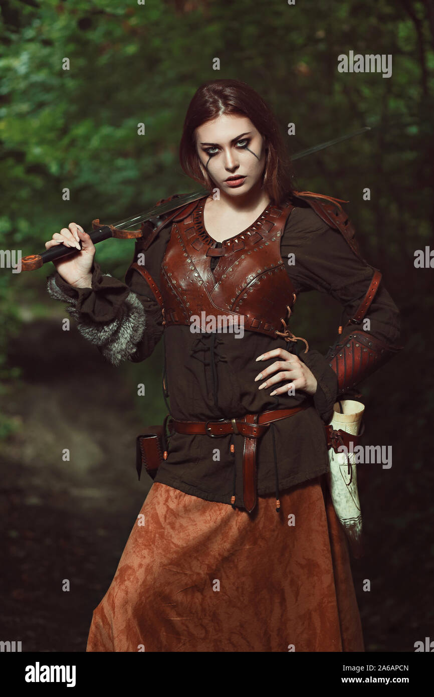 Beautiful female fighter with sword Stock Photo