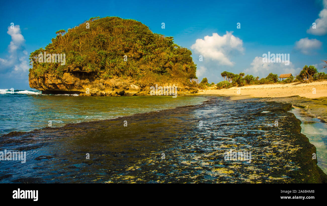 Tropical Island In The Sea Goa Cina Beach Malang East Java Indonesia Stock Photo Alamy