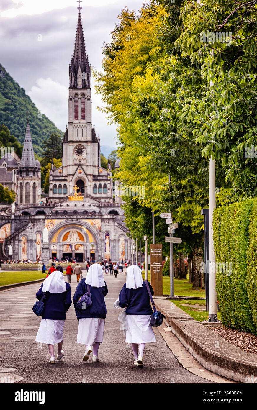 LOURDES - JUNE 15, 2019: View of nuns on the bottom of Notre-Dame du Rosaire basilica in Lourdes, France Stock Photo