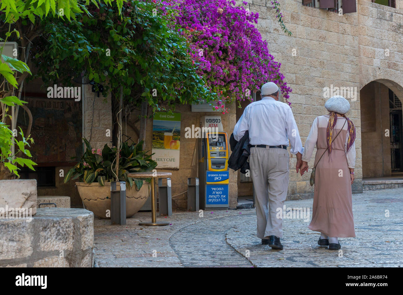 Living in Jerusalem. Everyday life in sacred city of Jerusalem.  Old couple walking hand on hand in Armenian Quarter of Jerusalem Stock Photo