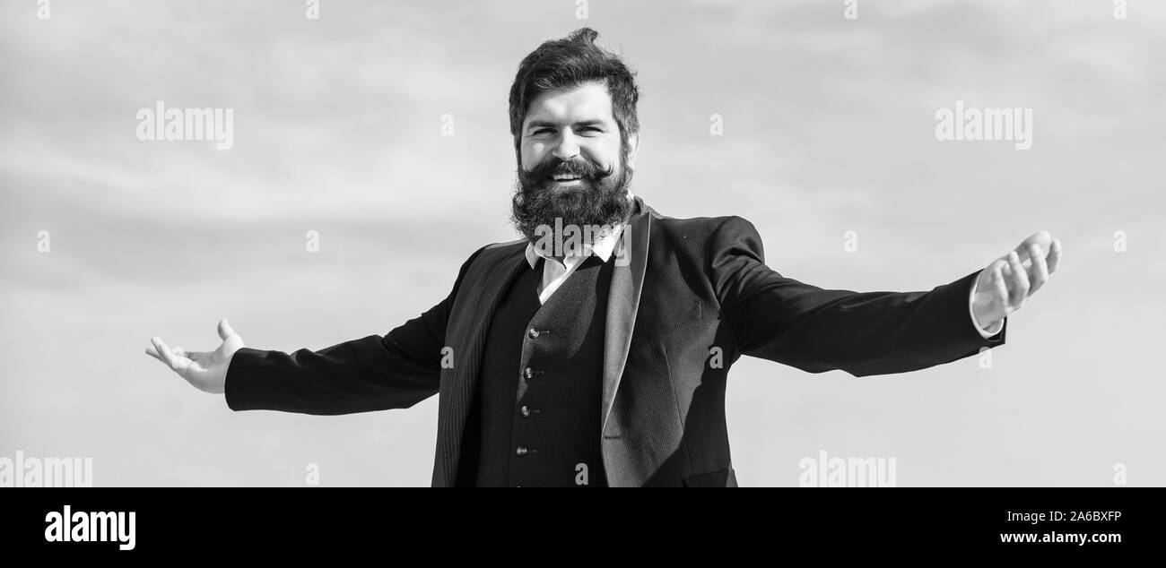 Guy enjoy top achievement. Man bearded proud himself sky background. Superiority and power. Feeling undefeated. Proud of himself. Self proud and narcissistic. Hipster bearded attractive enjoy freedom. Stock Photo
