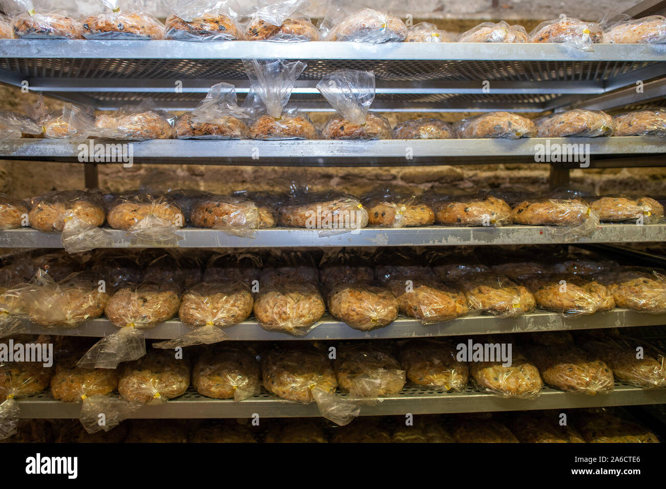 24 October 2019, Saxony-Anhalt, Halberstadt: Fresh Stollen is stored in the Remter cellar of the cathedral. The bread-like cake covered with icing sugar is to be stored in the Remter cellar of the cathedral in the coming weeks and matured in the constant climate of the vault. The Halberstadt cathedral gallery will be cut on 30 November 2019 in the cathedral during a devotion. Photo: Klaus-Dietmar Gabbert/dpa-Zentralbild/ZB Stock Photo