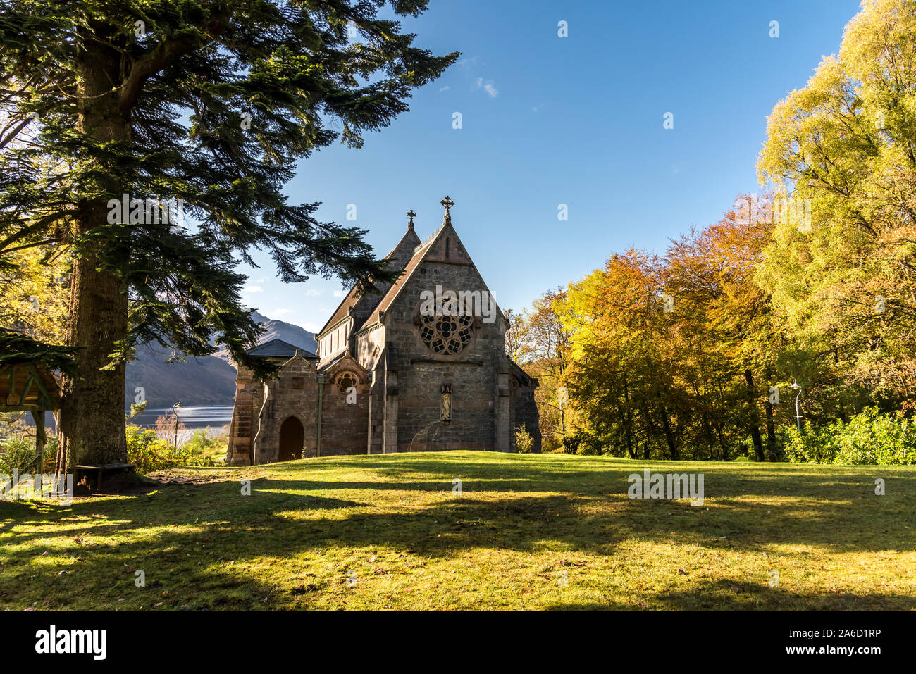 St Mary's Church in autumn colours near Glen Finnan memorial to Bonnie Prince Charlie on the shore of Loch Shiel  in the Western Highlands of Scotland Stock Photo