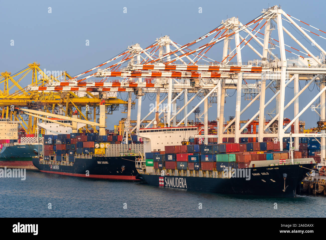 Laem Chabang seaport, Thailand - March 17, 2019: Two black and red Samudera container ship, Sinar Solo and Sinar Sabang, Singapore flagged, being work Stock Photo