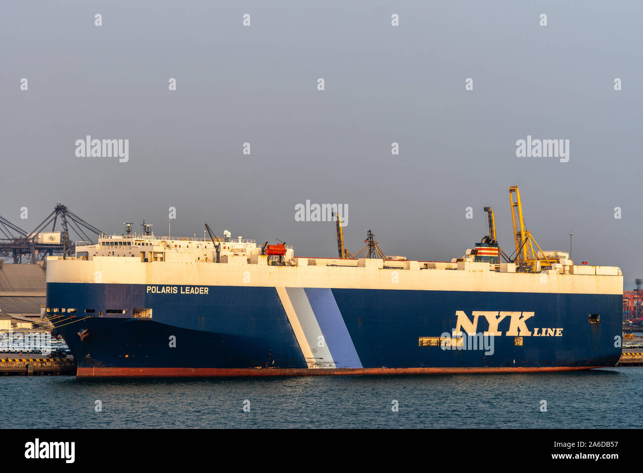 Laem Chabang seaport, Thailand - March 17, 2019: Closeup of Large blue-white NYKline vehicle carrier, Polaris Leader, flagged in Singapore, docked und Stock Photo