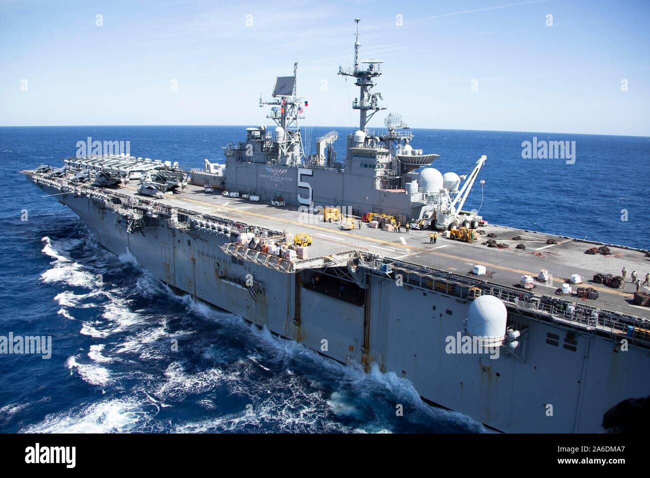 191023-N-MH210-1519  ATLANTIC OCEAN (Oct. 23, 2019) - The amphibious assault ship USS Bataan (LHD 5) sails the Atlantic Ocean, Oct. 23, 2019. Bataan is underway conducting a composite training unit exercise (COMPTUEX) with the Bataan Amphibious Ready Group and 26th Marine Expeditionary Unit. (U.S. Navy photo by Mass Communication Specialist 2nd Class Zachary A. Anderson) Stock Photo